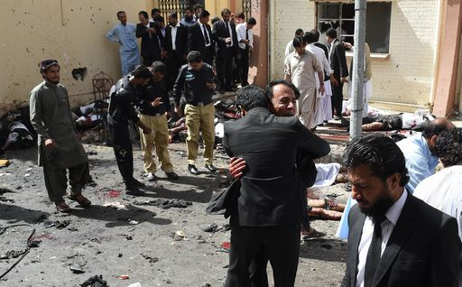 EDITORS NOTE: Graphic content / Pakistani lawyers react as they stand near the bodies of victims of a bomb explosion at a government hospital premises in Quetta on August 8, 2016. At least 20 people have been killed after a bomb went off at a major hospital in the southwest Pakistani city of Quetta, an AFP reporter and officials said, with fears the death toll could rise. GRAPHIC CONTENT / AFP PHOTO / BANARAS KHAN